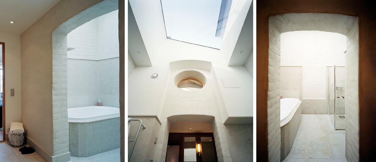 Ljust badrum med takfönster ger ett behagligt ljus när en råvind omvandlades till ett hem av Rex Arkitektbyrå