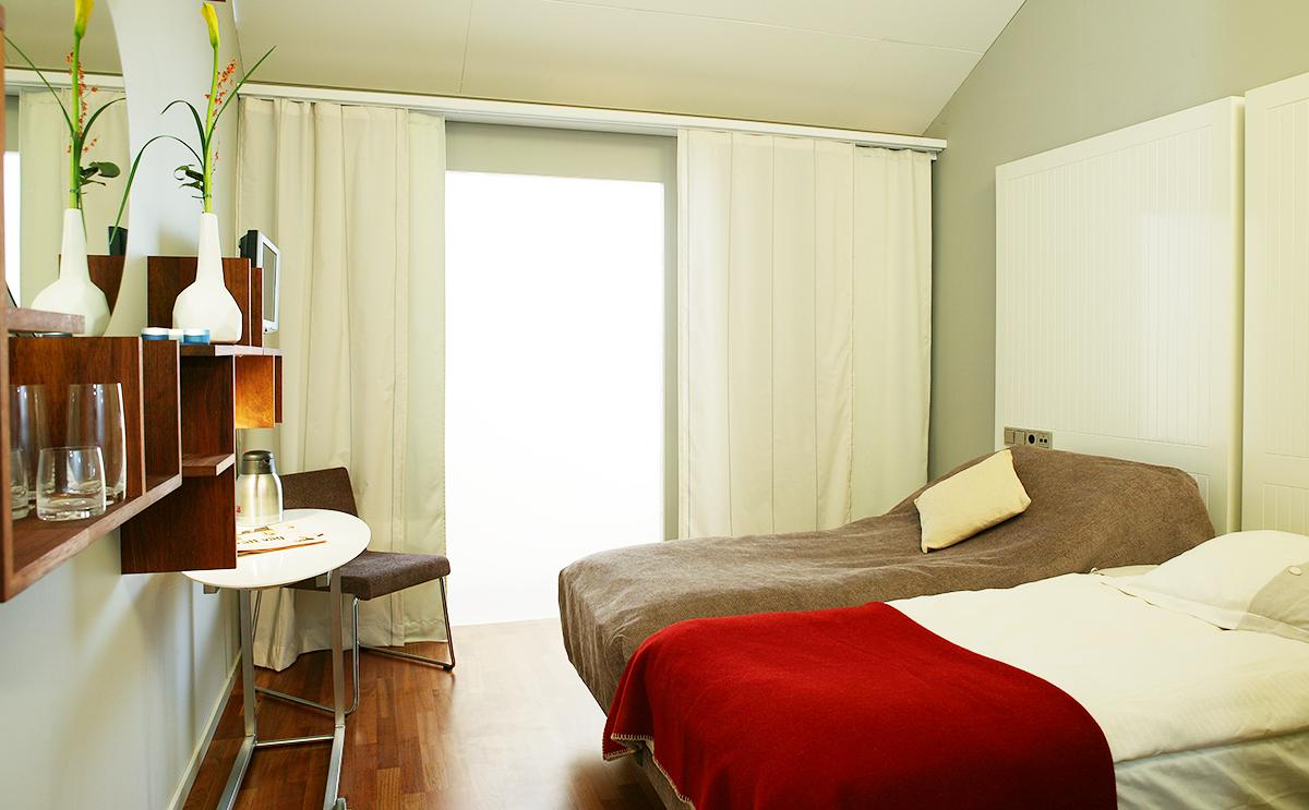 Hotellrum i Hotell Packhuset ritat av Rex Arkitektbyrå