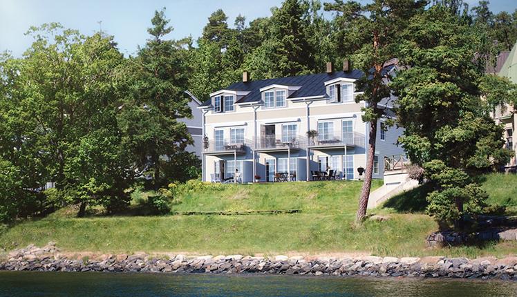 Vy från vattnet på nya bostadsområdet Stensnäs, av Rex Arkitektbyrå